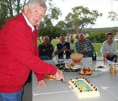 Paul cuts the cake